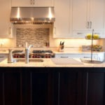 Kitchen remodeling in Naperville, IL. a recessed tile niche installed above oven range to hold cooking oil