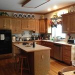 custom home kitchen design with island and two stools