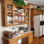 home kitchen design with custom cabinets and bookshelf